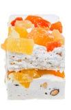 Nougat close up. Nougat with dried fruits close up isolated on white background Stock Image