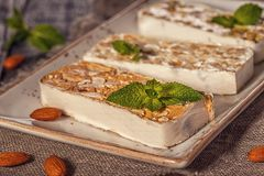 Nougat with honey and nuts, selective focus. Royalty Free Stock Images