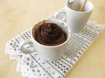 Nougat mug cake with chocolate topping Royalty Free Stock Images