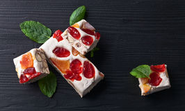 Nougat with tropical fruit and peppermint leaves Royalty Free Stock Image