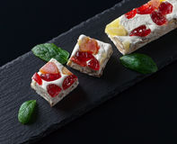 Nougat with tropical fruit and peppermint Royalty Free Stock Images