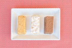 Nougat, a typical dessert of Christmas in Spain. Soft, hard and chocolate nougat Royalty Free Stock Photos