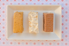 Nougat, a typical dessert of Christmas in Spain. Soft, hard and chocolate nougat Stock Photography