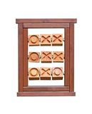 Noughts and Crosses. A Wooden Frame for Playing Noughts and Crosses Royalty Free Stock Images