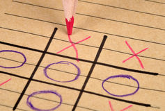 Noughts and Crosses. A game of noughts and crosses being played on a notepad page Stock Photos