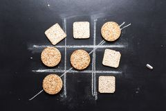 Noughts and Crosses Between Useful Circle Square. Noughts and Crosses Choice Competition Game Circle and Square Useful Low-Calorie Product Food Diet Creative Stock Photos