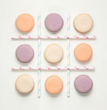 Noughts and crosses. Creative concept photo of macaroons and straws as noughts and crosses game Stock Images