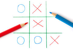 Noughts and crosses game. Isolated on white background Royalty Free Stock Photos