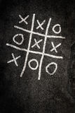 Noughts and Crosses game. On paving Stock Photos