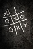 Noughts and Crosses game. On paving Stock Image