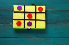 Noughts and crosses game. Flat lay of handmade Noughts and crosses game mad out of felt creations Quiet Book. Childhood lifestyle copy space Royalty Free Stock Photos