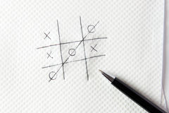 Noughts and crosses. Hand drawn tic tac toe game on napkin with pen Royalty Free Stock Photo
