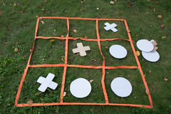 "Noughts and crosses. A huge board game to play ""noughts and crosses"" on the grass Royalty Free Stock Images"