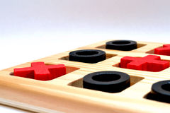 Noughts And Crosses. Wooden gamed named Noughts and Crosses Royalty Free Stock Images