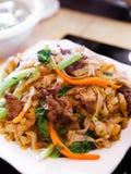 Nouille de riz chinoise mise le feu Photographie stock