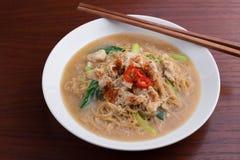 Nouille frite avec du porc et le légume ` Thaïlandais-chinois de Rad Na de ` de plat de nouille Photos libres de droits