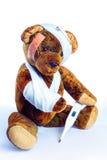 Nounours antique comme Invalider avec le bras dans le bandage et un thermomètre Image stock