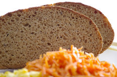Nourishing bread. Slices of bread with the vegetables by the closeup Stock Image