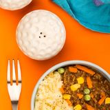 Nourishing Cottage Pie Meal In A Bowl. Against An Orange Background Royalty Free Stock Photos