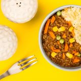 Nourishing Cottage Pie Meal In A Bowl. Against A Yellow Background Royalty Free Stock Photo