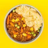Nourishing Cottage Pie Meal In A Bowl. Against A Yellow Background Stock Photos
