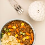 Nourishing Cottage Pie Meal In A Bowl. Agasinst A Light Grey Background Royalty Free Stock Image