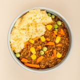 Nourishing Cottage Pie Meal In A Bowl. Agasinst A Light Grey Background Royalty Free Stock Photo