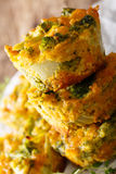 Nourishing food: broccoli muffins with cheddar cheese close-up. Nourishing food: broccoli muffins with cheddar cheese close-up on the table. vertical Stock Images