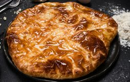 Nourishing imeretian khachapuri recipe fatty. Nourishing imeretian khachapuri recipe. fatty delicious unhealthy food. georgian cuisine Royalty Free Stock Image