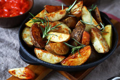 Nourishing potatoes in a pan Royalty Free Stock Images
