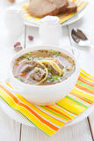 Nourishing soup with vermicelli and beef in a white tureen Royalty Free Stock Images