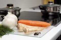 Nourriture crue et cuisson Photographie stock libre de droits