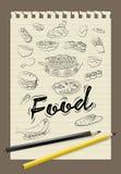 Nourriture d'aspiration de main de griffonnage Photos libres de droits