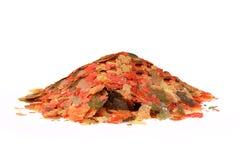 Nourriture de flocon pour tous les poissons tropicaux d'aquarium Photo libre de droits