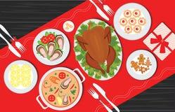 Nourriture de Noël sur la table, table pour des vacances de fête romantiques Image stock