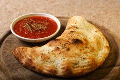 Nourriture italienne - calzone Photographie stock libre de droits