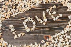 Nourriture malsaine de fond de texture d'amour de maïs éclaté Images stock