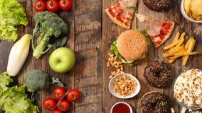 Nourriture malsaine ou saine photo stock