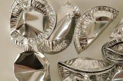 Nourriture ronde de papier aluminium d'isolement Photographie stock