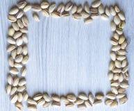 Nourriture saine pour la fin de fond d'image vers le haut des pistaches ?crous de texture sur la moquerie de vue sup?rieure  image libre de droits