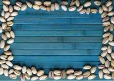 Nourriture saine pour la fin de fond d'image vers le haut des pistaches ?crous de texture sur la moquerie de vue sup?rieure vers  photographie stock libre de droits