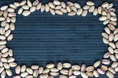 Nourriture saine pour la fin de fond d'image vers le haut des pistaches ?crous de texture sur la moquerie de vue sup?rieure vers  images libres de droits