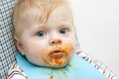 Nourriture sur le visage Photographie stock libre de droits