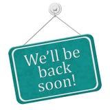 Nous ll de ` soyons de retour bientôt signe Photo stock