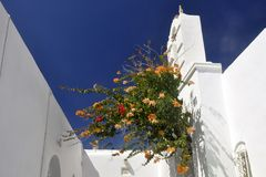Noussa  Old Town church and flowers Royalty Free Stock Images