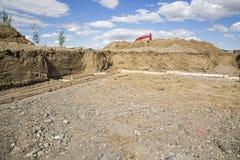 Nouveau fond à la maison d'excavation de construction Images stock