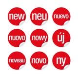 Nouveau label dans différentes langues du monde Photos libres de droits