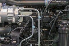 Nouveau moteur tracteur diesel agricole moderne Nouveau moteur de pointe moderne de chargeur ou de petit tracteur Vue supérieure  images libres de droits