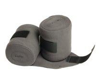 Nouveaux bandages gris de tricots de cheval d'isolement sur le blanc Photographie stock