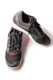 Nouveaux noir et rouge sans marque de couleur de chaussure de course Photographie stock